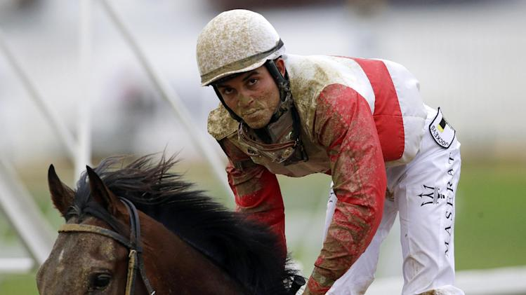 There are at least two sides to every tale. On the losing end of the Preakness was Kentucky Derby winner Orb, with jockey Joel Rosario aboard. As documented by Yahoo! Sports' Les Carpenter, Orb is just the latest horse to fall short of the Triple Crown dream. (AP)