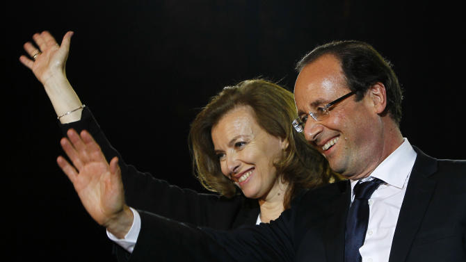 French president-elect Francois Hollande and his companion Valerie Trierweiler wave to supporters after greeting crowds gathered to celebrate his election victory in Bastille Square in Paris, France, Sunday, May 6, 2012. France handed the presidency Sunday to leftist Hollande, a champion of government stimulus programs who says the state should protect the downtrodden - a victory that could deal a death blow to the drive for austerity that has been the hallmark of Europe in recent years. (AP Photo/Francois Mori)