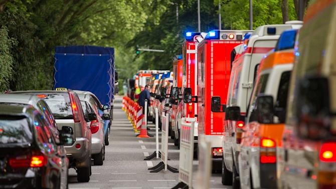 Ambulances line up in front of a building of social services during an evacuation of 20,000 from their homes in Cologne, western Germany, on May 27, 2015