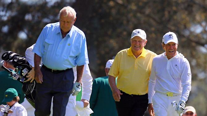 Arnold Palmer, from left, Jack Nicklaus and Gary Player walk down the first fairway after teeing off during the par-three contest before the Masters golf tournament, Wednesday, April 10, 2013, in Augusta, Ga. (AP Photo/Atlanta Journal-Constitution, Curtis Compton)