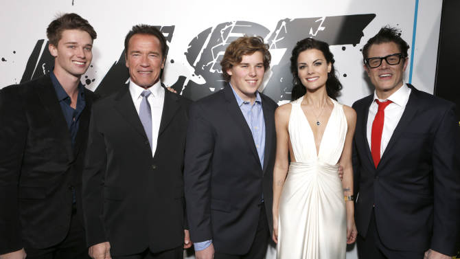 """Patrick Schwarzenegger, Arnold Schwarzenegger, Chris Schwarzenegger, Jaimie Alexander and Johnny Knoxville attend the LA premiere of """"The Last Stand"""" at Grauman's Chinese Theatre on Monday, Jan. 14, 2013, in Los Angeles. (Photo by Todd Williamson/Invision/AP)"""