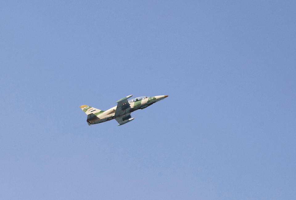 In this Sunday, Sept. 23, 2012 photo, a Syrian army jet is seen after attacking a residential area near the Dar al Shifa hospital in Aleppo, Syria. (AP Photo/ Manu Brabo)