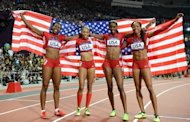 (L-R) Americans Francena McCorory, Allyson Felix, Deedee Trotter and Sanya Richards-Ross celebrate after winning the women&#39;s 4x400m relay final at the London Olympics on August 11. US women won 29 of America&#39;s medals-table-leading 46 golds