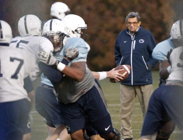Penn State coach Joe Paterno watches his football team practice, Wednesday, Nov. 9, 2011, in State College, Pa. Paterno, who preached success with honor for half a century but whose legend was shatter