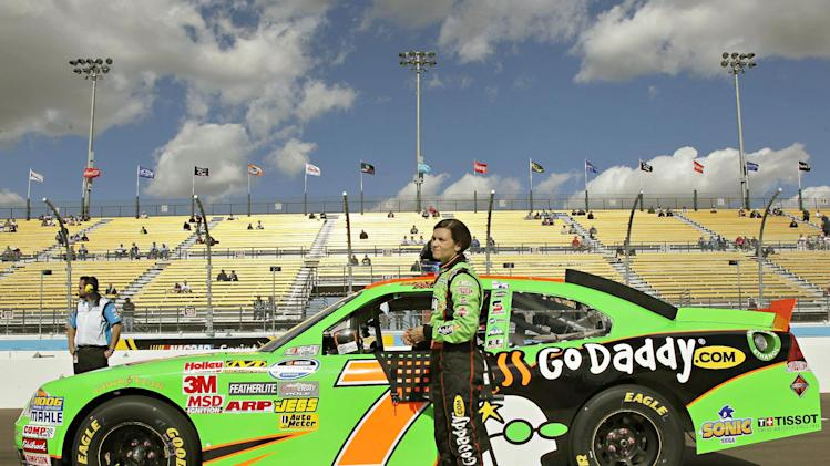 Driver Danica Patrick stands outside her car after qualifying for the NASCAR Nationwide Series auto race, Saturday, Nov. 10, 2012, at Phoenix International Raceway in Avondale, Ariz. (AP Photo/Matt York)