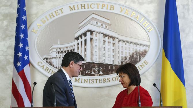 Ukrainian Finance Minister Natalia Yaresko and U.S. Treasury Secretary Jack Lew shake hands during a joint news conference in Kiev