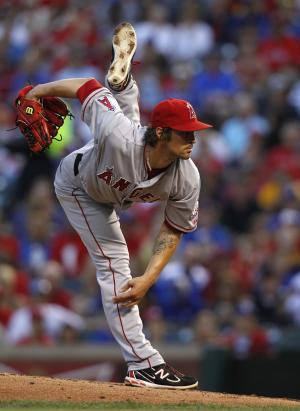 Los Angeles Angels' C.J. Wilson follows through on his delivery to the Texas Rangers in the first inning of a baseball game Friday, May 11, 2012, in Arlington, Texas. (AP Photo/Tony Gutierrez)