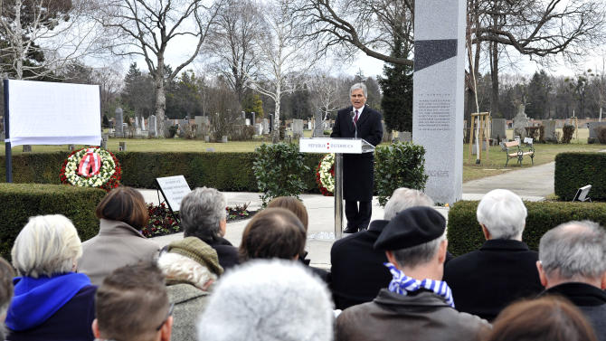 """Austrian Chancellor Werner Faymann delivers a speech during the unveiling of a plaque honoring the thousands of Austrians killed by the Nazis for opposing them, before and after the so-called """"Anschluss"""" at the Central Cemetary in Vienna, Austria, Monday, March 11, 2013. Austria's chancellor has urged fellow Austrians to strive to prevent a return of the political climate that allowed Nazi atrocities, in comments marking Germany's annexation of Austria 75 years ago. (AP Photo/Hans Punz)"""