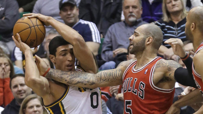 Chicago Bulls' Carlos Boozer (5) vies with Utah Jazz's Enes Kanter (0) for a rebound in the second quarter during an NBA basketball game Friday, Feb. 8, 2013, in Salt Lake City. (AP Photo/Rick Bowmer)