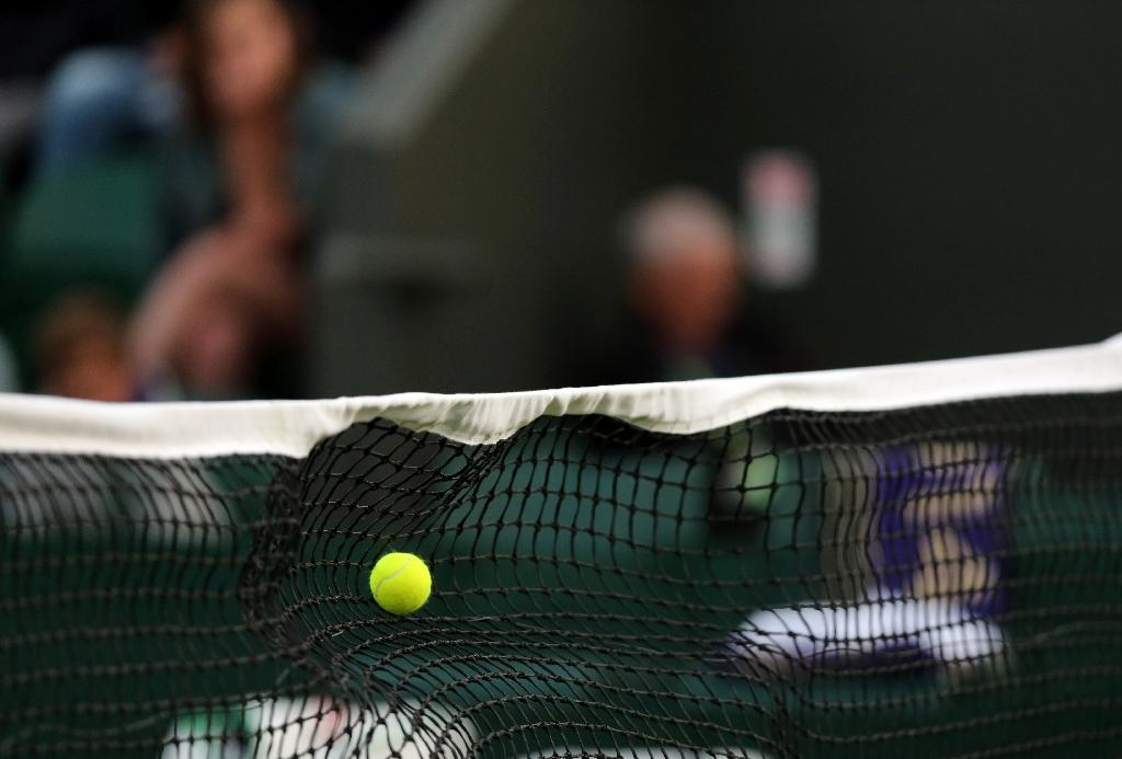 Two tennis umpires banned, four probed over corruption