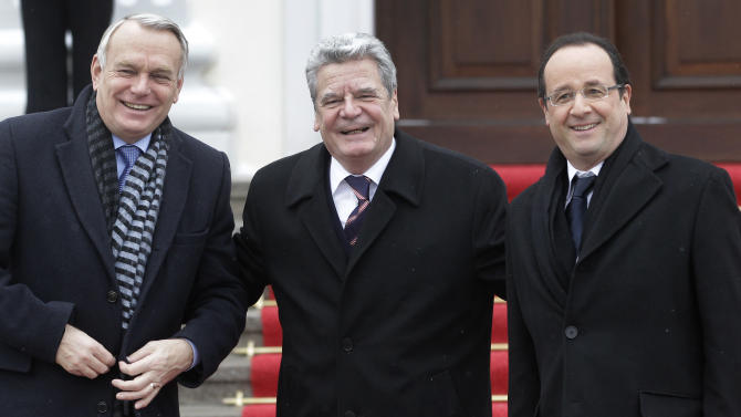 German President Joachim Gauck, center, welcomes President of France Francois Hollande, right, and Prime Minister of France Jean-Marc Ayrault, left, at the Bellevue Palace in Berlin, Germany, Tuesday, Jan. 22, 2013. The governments of Germany and France have a one day meeting in Berlin to mark the 50th anniversary of the Elysee Treaty. (AP Photo/Michael Sohn)