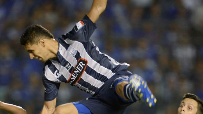 Gimenez of Ecuador's Emelec jumps over Macedo of Brazil's Goias during their Copa Sudamericana match in Guayaquil