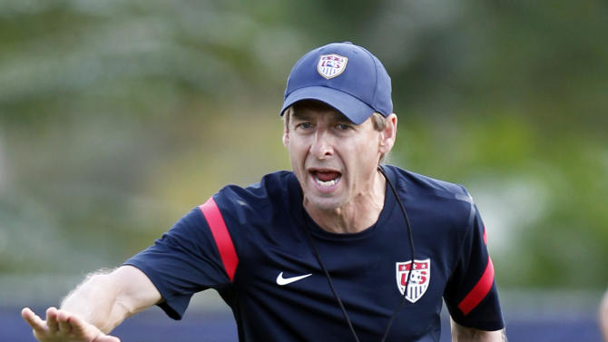 U.S. men's national soccer team head coach Jurgen Klinsmann calls out to players during a workout, Tuesday, Oct. 9, 2012 in Miami. The U.S. plays at Antigua and Barbuda on Friday Oct. 12, and in Kansas City against Guatemala on Oct. 16, in two World Cup qualifying matches. (AP Photo/Wilfredo Lee)