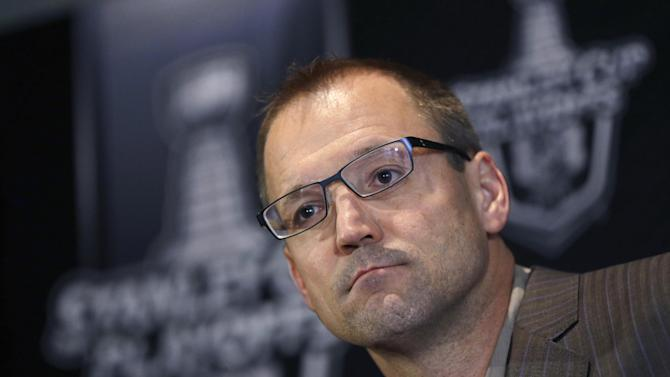 FILE - In this June 6, 2013, file photo, Pittsburgh Penguins coach Dan Bylsma listens to a question during an NHL hockey news conference in Boston. USA Hockey hired Bylsma on Saturday, June 29, 2013, as the coach for the U.S. Olympic men's hockey team at the 2014 games in Sochi, Russia. (AP Photo/Elise Amendola, File)