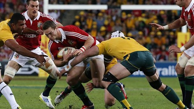 Australia's Wycliff Palu (L) and Ben Mowen (R) tackle British and Irish Lions' George North during their Test match (Reuters)