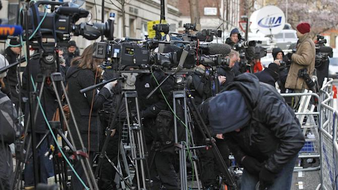 Media gather outside the King Edward VII hospital in central London where Kate, the Duchess of Cambridge has been admitted with a severe form of morning sickness, Tuesday, Dec. 4, 2012.  Prince William and his wife Kate are expecting their first child, it was announced Monday.  The Duchess of Cambridge is suffering from a severe form of morning sickness in the early stages of her pregnancy, and is widely expected to stay in hospital for several days.  (AP Photo/Sang Tan)