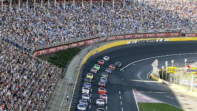 Drivers approach the start/finish line to begin the NASCAR Sprint Cup Series Coca-Cola 600 auto race in Concord, N.C., Sunday, May 27, 2012. (AP Photo/Gerry Broome)