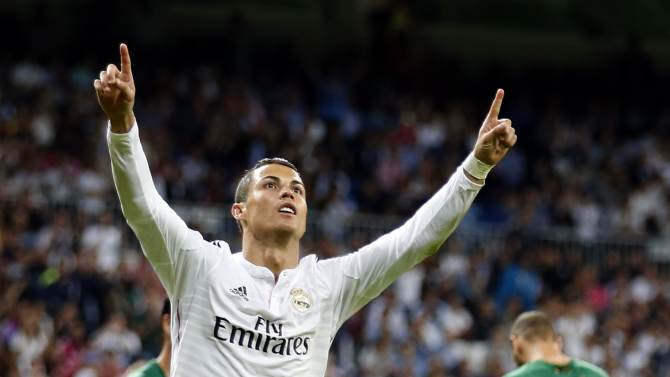 Real Madrid's Ronaldo celebrates after scoring a hat-trick against Elche during their Spanish first division soccer match in Madrid