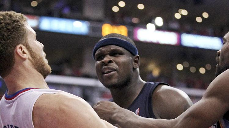 Los Angeles Clippers' Blake Griffin and Memphis Grizzlies' Zach Randolph are separated during the first half of a NBA first-round playoff basketball game in Los Angeles, Monday, May 7, 2012. (AP Photo/Chris Carlson)