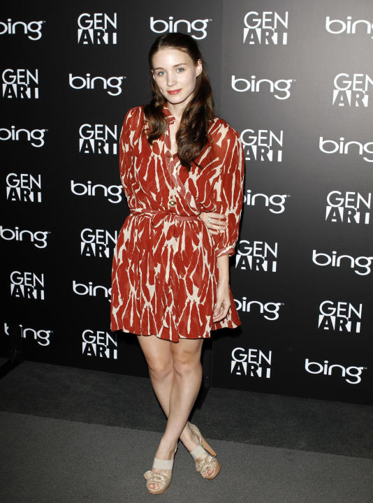 Rooney in a printed dress