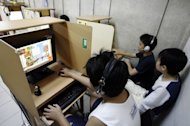 Children play computer games in Singapore