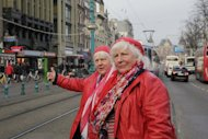"Twins Martine (L) and Louise Fokkens , aged 70, walk around the centre of Amsterdam. The jaunty pair are the Dutch capital's oldest prostitutes. Since the early 1960s, first Louise and later Martine have been plying their trade around the infamous ""Wallen"" (Dutch for 'canal banks'), the world's best-known red light area"