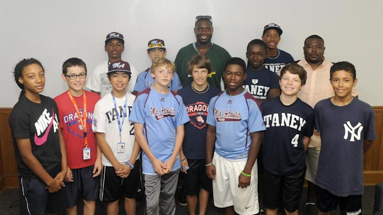 IMAGE DISTRIBUTED FOR SUBWAY - Ryan Howard, back row center, poses with the Mid-Atlantic Region Champions (Taney Youth Baseball Little League, Philadelphia, PA) at the Little League Baseball World Series during SUBWAY Restaurants Little League Throwback Thursday social media campaign on Thursday, August 21, 2014, in South Williamsport, PA. (Photo by Jimmy May/Invision for SUBWAY Restaurants/AP Images)