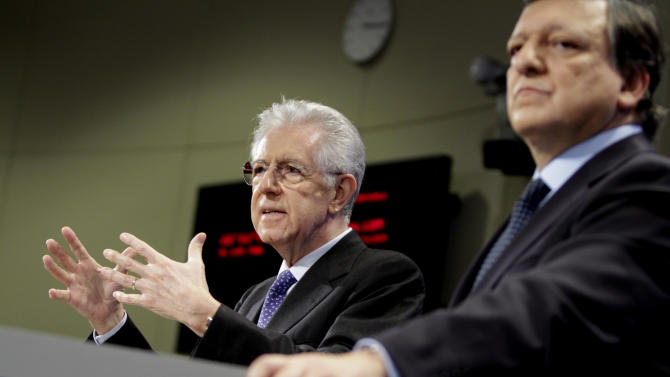 Italian Prime Minister Mario Monti, left, speaks during a joint media conference with European Commission President Jose Manuel Barroso at EU headquarters in Brussels, on Tuesday, Nov. 22, 2011. (AP Photo/Virginia Mayo)