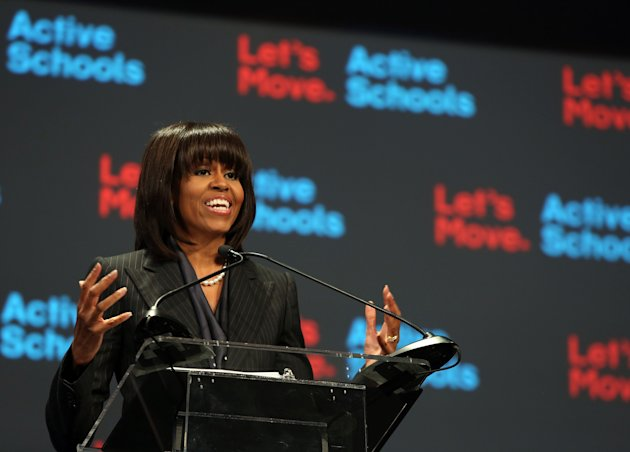"CHICAGO,IL - FEBRUARY 28: First lady Michelle Obama speaks about a school exercise program February 28, 2013 in Chicago, Illinois. Obama unveiled a new initiative called ""Let's Move Active Schools"" to help schools create a physical activity programs for students. (Photo by Tasos Katopodis/Getty Images)"