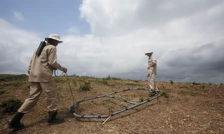 File photo of MAG workers detecting for UXOs on hill in Vietnam's central Quang Tri province
