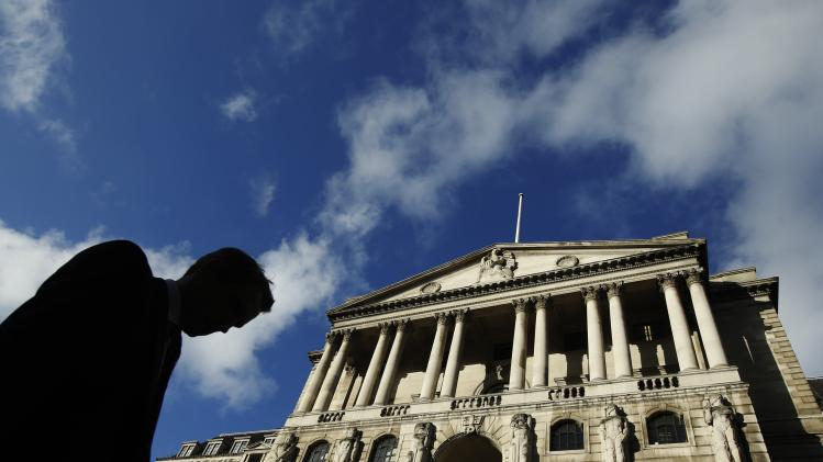 File photo shows a man passing the Bank of England in London