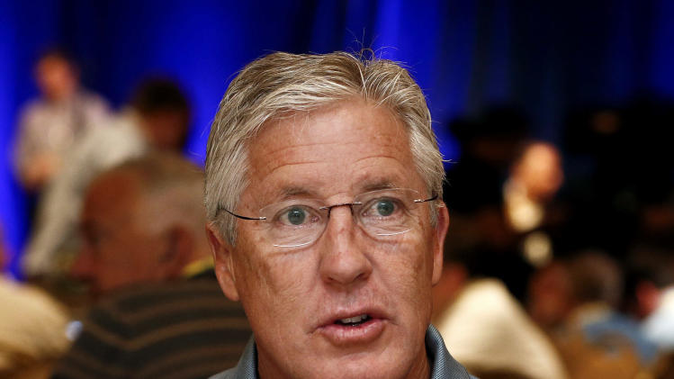 Seattle Seahawks head coach Pete Carroll speaks with the media at the NFC coaches breakfast at the NFL football annual meetings Wednesday, March 20, 2013, in Phoenix. (AP Photo/Ross D. Franklin)