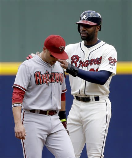 Heyward sparks 7-run 8th, Braves beat Arizona