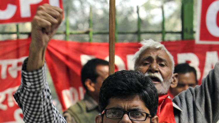 Communist Party of India (CPI) supporters shout slogans against the government during a protest against hike in petrol prices in New Delhi, India, Saturday, Nov. 5, 2011. Petrol price was raised for a fourth time this year, with allies of the government threatening to withdraw support unless it withdraws the hike, according to news reports. (AP Photo/ Mustafa Quraishi)