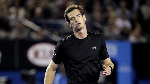 Andy Murray of Britain reacts to a lost point to   Grigor Dimitrov of Bulgaria during their fourth round match at the Australian Open tennis championship in Melbourne, Australia, Sunday, Jan. 25, 2015. (AP Photo/Bernat Armangue)