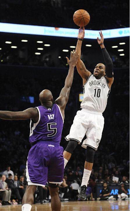 Brooklyn Nets' Marcus Thornton (10) shoot over Sacramento Kings' Quincy Acy (5) in the first half of an NBA basketball game on Sunday, March 9, 2014 at Barclays Center in New York. The Nets wo