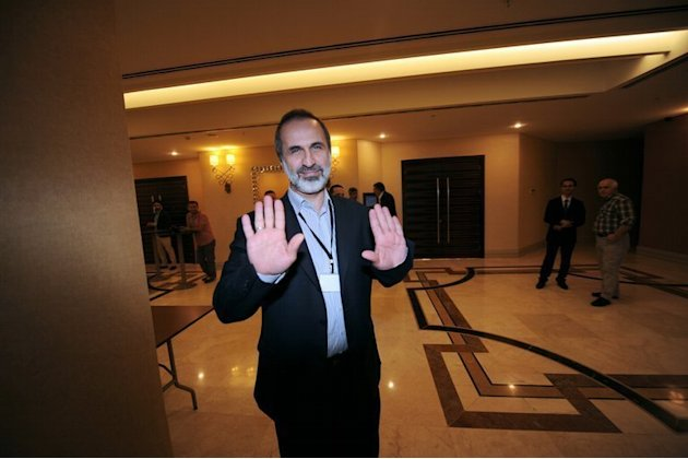 Ahmed Moaz al-Khatib, a member of Syria's opposition coalition, attends a meeting on May 23, 2013, in Istanbul