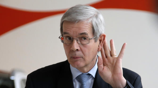 PSA Peugeot Citroen Chief Executive Philippe Varin delivers his speech during a news conference in Paris Wednesday, Feb. 13, 2013. The Paris-based company posted a record 5 billion Euros ($6.7 billion) loss last year after Europe's cratering car market forced France's largest automaker to book a 3 billion Euros financial charge. (AP Photo/Francois Mori)