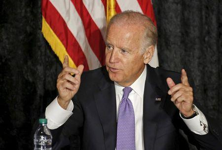 Normally loquacious Biden hits the road but stays mum on 2016