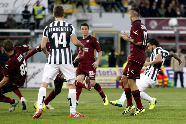 Juventus Tevez scores against Livorno during their Italian Serie A soccer match in Livorno
