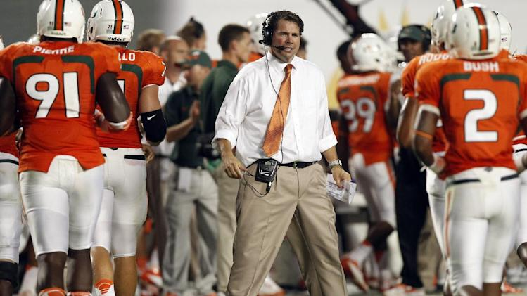 Miami head coach Al Golden, center, watches from the sideline during the first half of an NCAA college football game, against Florida State Saturday, Oct. 20, 2012, in Miami. (AP Photo/Alan Diaz)