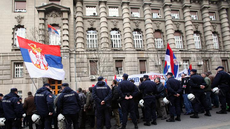 Protesters wave Serbian flags during the protest of Serbian nationalist organization Obraz (Honour) in front of the Government building in Belgrade, Serbia, Monday, April 8, 2013. Deputy Prime Minister Aleksandar Vucic says his government will reject an EU-brokered deal for Kosovo and will ask for more negotiations with ethnic Albanian leaders. The EU has given Serbia until Tuesday to say whether it would relinquish its control of northern Kosovo in exchange for the start of Serbia's EU membership negotiations. Serbia's government says it will give the answer later Monday. (AP Photo/Darko Vojinovic)