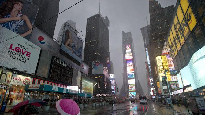 Pedestrians walk through Times Square as snow falls Friday, Feb. 8, 2013, in New York. A blizzard of potentially historic proportions threatens to strike the Northeast with 1 to 2 feet of snow forecast along the densely populated Interstate 95 corridor from New York City to Boston and beyond. (AP Photo/Frank Franklin II)