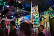 People at a gay club in Hong Kong. A new smartphone app aims to put members of the lesbian, gay, bisexual and transgender community in touch with businesses deemed friendly to sexual minorities in socially conservative Hong Kong