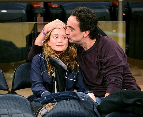 Olivier Sarkozy, 42, Kisses Mary-Kate Olsen, 26, at New York Knicks Game