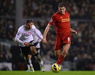 Liverpool's midfielder Steven Gerrard (R) clashes with Fulham's defender Aaron Hughes during their English Premier League football match at Anfield in Liverpool, north-west England on December 22, 2012. Liverpool won the game 4-0