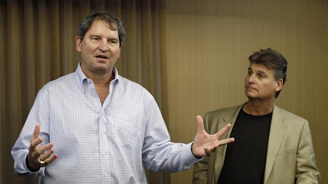 "In this Jan. 10, 2013 file photo, former Cleveland Browns quarterback Bernie Kosar, left, speaks at a news conference with Dr. Rick Sponaugle, in Middleburg Heights, Ohio . Thursday, Jan. 10, 2013. Kosar believes he's been unfairly sacked as a TV broadcaster. Kosar contends he's been removed because of slurred speech he attributes to ""a direct result of the many concussions I received while playing in the NFL."""
