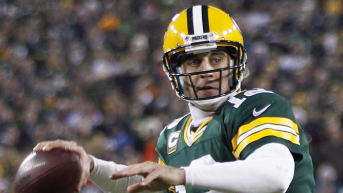 Green Bay Packers quarterback Aaron Rodgers looks to throw a pass during the first half of an NFL wild card playoff football game against the Minnesota Vikings Saturday, Jan. 5, 2013, in Green Bay, Wis. (AP Photo/Mike Roemer)
