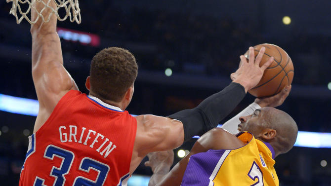 Los Angeles Lakers guard Kobe Bryant (24) shoots as Los Angeles Clippers forward Blake Griffin (32) defends during the first half of their NBA basketball game, Thursday, Feb. 14, 2013, in Los Angeles.  (AP Photo/Mark J. Terrill)