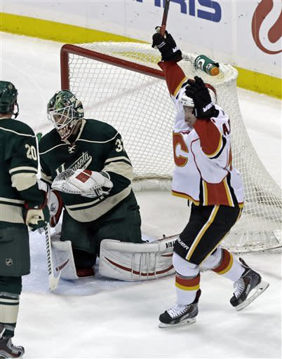 Flames keep Wild treading water in playoff race